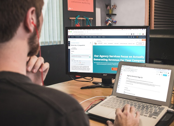 Marketer editing website content on two screens